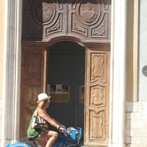Cycling past a church in Nice, France