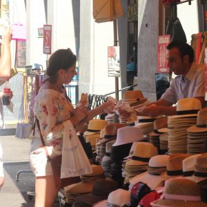 Man buying a hat in Vieux Nice